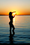 Silhouette of woman on sunset in the Baltic sea poster