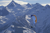 winter paragliding in alps mountains