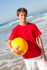 handsome teenage boy on beach