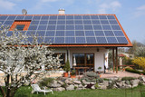 House with new solar moduls poster