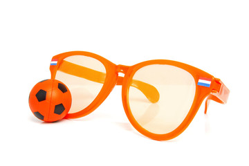 Orange socces accessories over white background