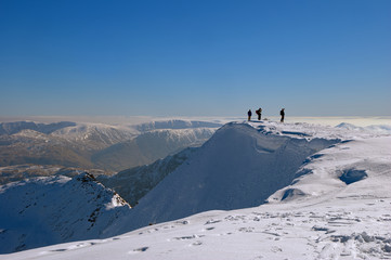 Mountaineers on snowy summit