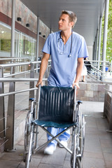 Male nurse with a wheelchair