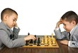 Boys playing chess, isolated on white