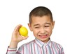 Boy holding a lemon , making a funny face