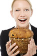 young  businesswoman smiling and holding a panettone