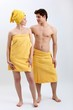 young woman and young man in towels