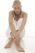 young woman dressed in white sitting on the floor