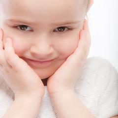 Beautiful smiling preschool child close up