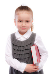 Portrait of beautiful schoolgirl with red book