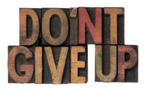 do not give up phrase in wooden type poster