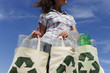 recycling: woman holding bag with plastic bottles