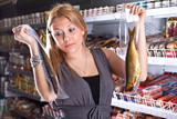 The buyer in shop chooses smoked fish poster