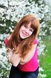 redheaded girl in blossom garden