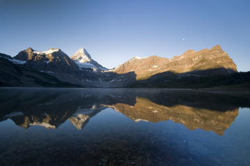 mountain range reflection in assiniboine provincial park