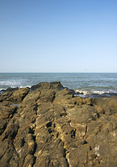 rocky shore on the Arabic sea, Goa, India