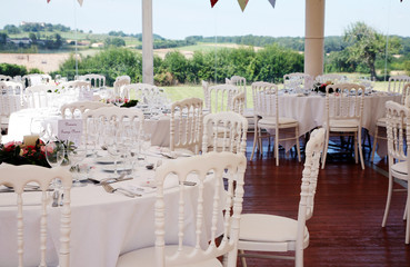 Table settings under a wedding marquee