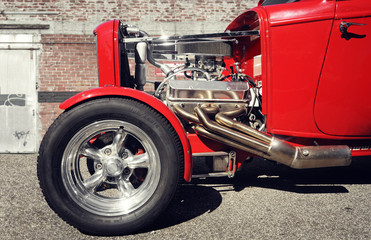 front part of a classic red hot rod