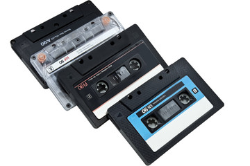 four audiocassettes isolated on a white background