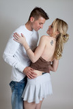 Romantic couple in affectionate hug poster