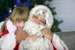 Portrait d'un Père Noël et d'une fillette