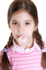 child make a bubble with chewing gum