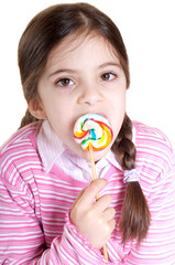 child with lollipop on white background
