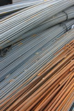 Bunch of concrete reinforcement steel rods in warehouse poster