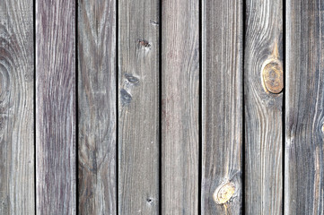 Black painted weathered wooden fence texture