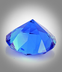 close up of blue diamond over white background
