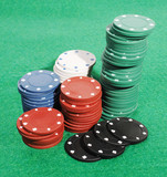 Casino chips on a green table