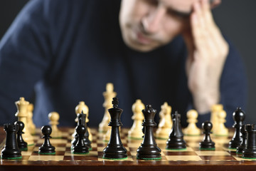 Man at chess board