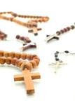 Religion diversity - rosary beads over white poster