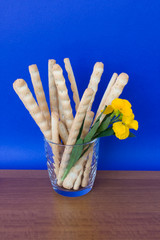 Glass With Bread-sticks And Flower