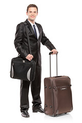 Businessman carrying his laptop and his luggage