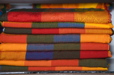 Mexico. .Souvenirs. .Pile of bright coverlets