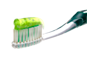 Toothbrush and paste on white background