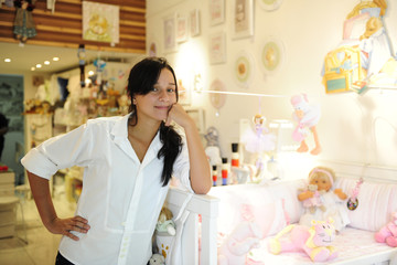 small business owner: proud woman opening her shop