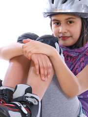 young girl on rollerblades