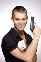 man with pink rose and gun