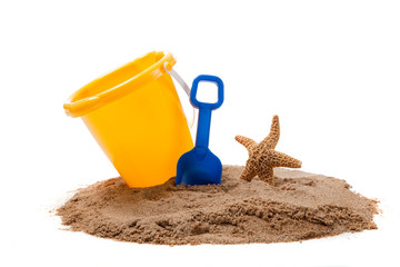 Bucket on a beach with a shovel and starfish