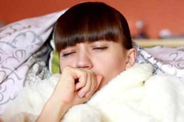 Woman in a bathrobe coughing
