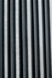 Seamless background of vertical rows of metal coil springs
