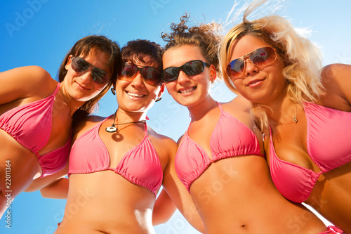 females in bikinis on the beach