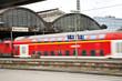 Leinwandbild Motiv train enters classicistic iron train station