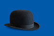 Bowler hat on blue background