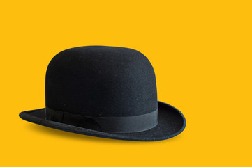 Bowler hat on yellow background
