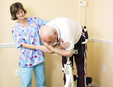 Physical Therapist Helping Patient poster