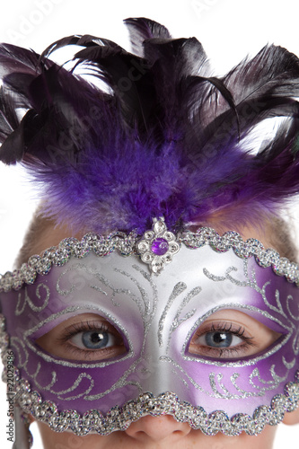 Girl in a purple mardi gras mask