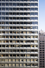 A repetitive office facade represents the modern workplace
